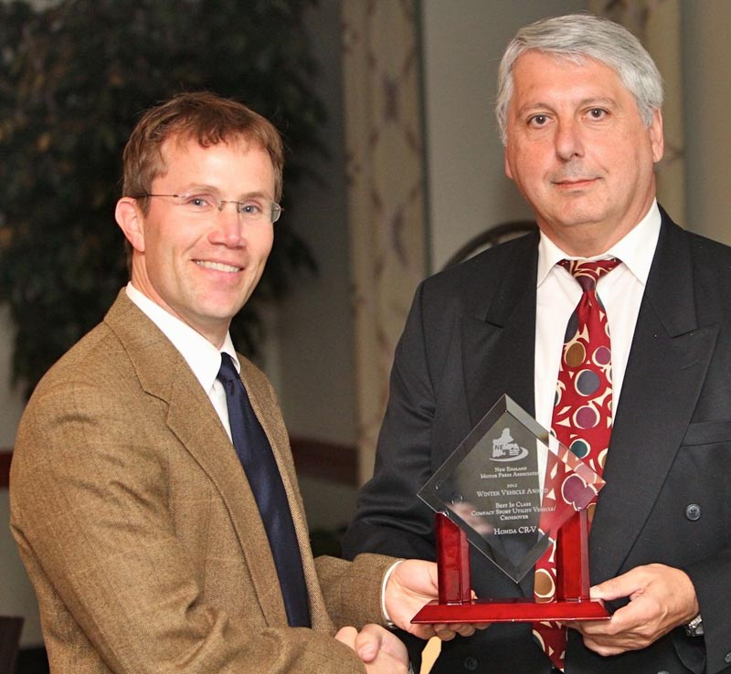 Honda's Chris Naughton accepts the BEST IN CLASS—COMPACT SPORT UTILITY VEHICLE/CROSSOVER award for the Honda CR-V from John Paul. The CR-V helped launch the non-truck-based SUV segment that came to be known as crossovers back in the 1990s. Honda hasn't been sitting on its laurels, however, and the CR-V was redesigned for 2012. Offering a newly refined and efficient engine, more space and excellent driving dynamics, the CR-V offers compact all-weather excellence at an affordable price. Many families have been lured to smaller SUV and crossover vehicles by exactly the sort of thoughtful interior design and functionality that Honda has included in the 2012 CR-V. There's lots of storage and a low liftover height, and the sophisticated available hands-free navigation and connectivity system reads text messages aloud. The Honda CR-V parlays its successful redesign into a spot as a top 2012 Winter Vehicle.
