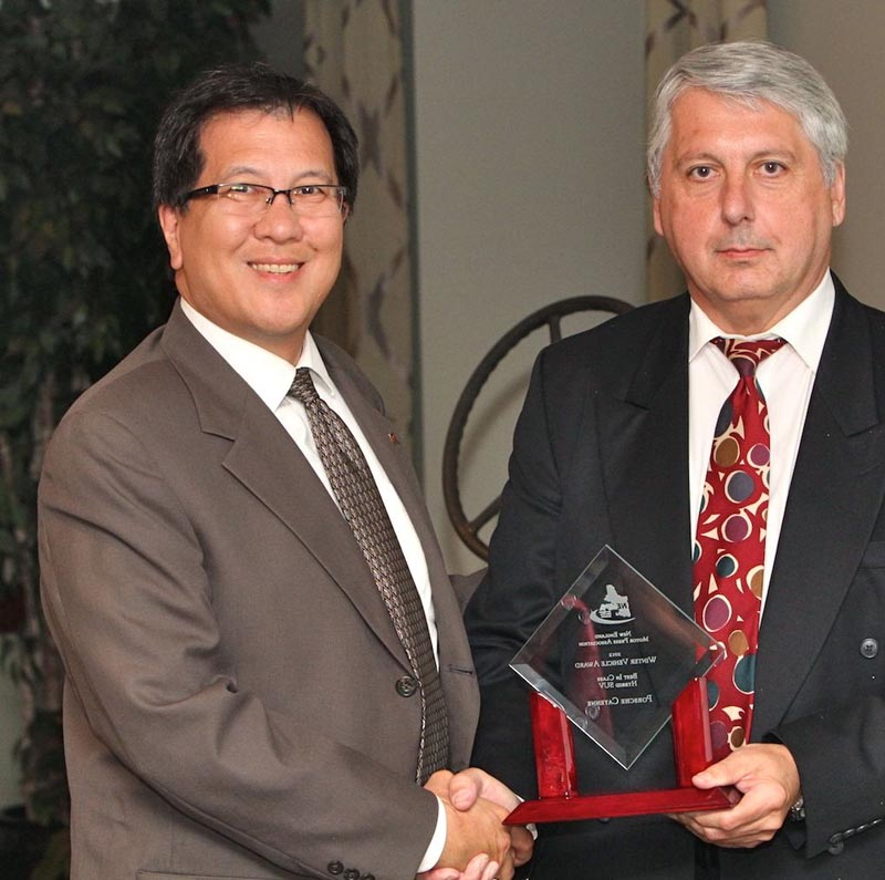 Gary Fong, Porsche Cars North America, accepts the award for BEST IN CLASS—HYBRID SPORT UTILITY VEHICLE for the Porsche Cayenne from NEMPA V-P John Paul. The Cayenne has proven itself as both a true Porsche and a sales success. This second-generation 2012 Cayenne is roomier than the original and more than 100 pounds lighter, and Porsche is defying convention again by offering one Cayenne model as its first production hybrid. The Cayenne S Hybrid uses a supercharged V-6 and two electric motors to provide propulsion and active all-wheel drive. It's a way to get Porsche quality and luxury with plenty of space for occupants and cargo without sacrificing performance. The hybrid Cayenne sprints to 60 MPH in 6.1 seconds and can reach 150 MPH, yet it can travel 24 highway miles per gallon. That's having your cake and eating it, too.