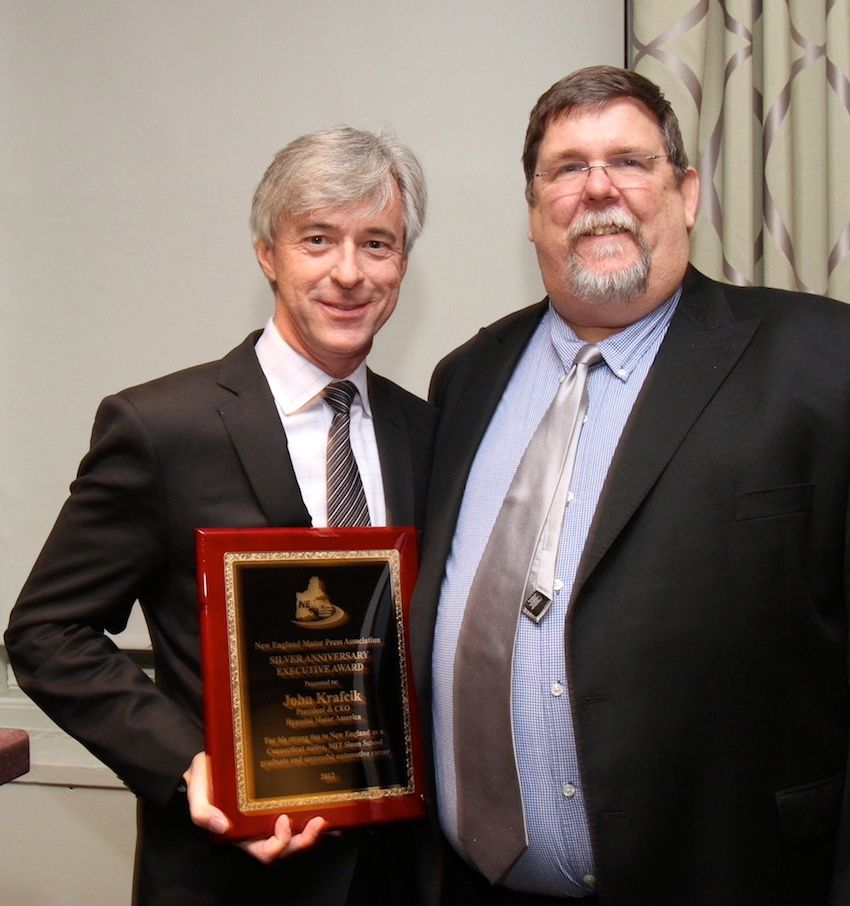 "John Krafcik, President & CEO, Hyundai Motor America, accepts THE SILVER ANNIVERSARY EXECUTIVE AWARD from NEMPA President Keith Griffin. Krafcik was cited for ""his strong ties to New England as a Connecticut native, MIT Sloan School graduate, and for his sterling success in the automotive industry."" Krafcik also accepted THE YANKEE CUP TECHNOLOGY AWARD for his company's Hyundai Gasoline Direct Injection. Previously a premium/luxury feature, Hyundai took the bold step of bringing Gasoline Direct Injection technology to nearly its entire fleet, from the sub-compact Accent all the way to its flagship Equus. GDI allows Hyundai vehicles to maximize fuel efficiency and reduce emissions. Selected in conjunction with faculty and staff at MIT, NEMPA's Yankee Cup annually goes to an automotive feature or system that significantly enhances the motoring experience, whether by making driving safer, more cost- efficient or simply more enjoyable."