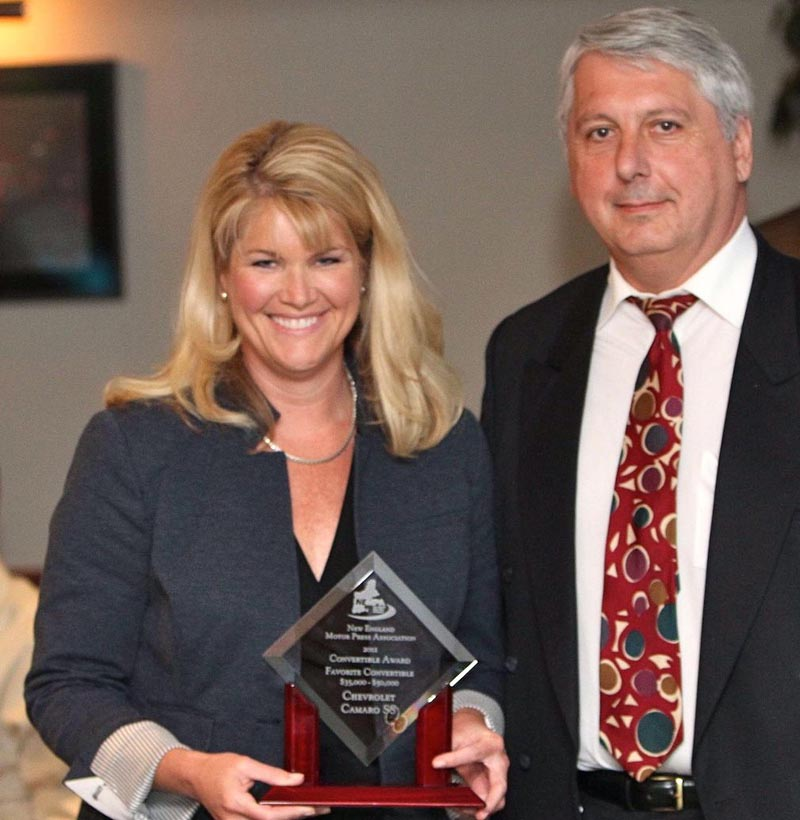 GM's Laura Toole accepts the award for BEST IN CLASS—PREMIUM SPORT UTILITY VEHICLE/CROSSOVER on behalf of the Cadillac Escalade, judged one of the pinnacles of luxury full-size sport-utility vehicles. The Escalade has earned this recognition over 13 years of crashing the luxury SUV party with a unique look and a red-blooded American V8. Efficiency goes hand-in-hand with muscle, thanks to cylinder deactivation. A strong frame boosts towing capacity, while available all-wheel drive and Magnetic Ride Control give this big SUV athletic reflexes even in quickly changing conditions. A leather-lined interior filled with technology for both passengers and drivers clinched our Winter voting. The swashbuckling Cadillac Escalade has the right stuff for the New England buyer looking for a premium package of all-season capability, capacity and comfort.