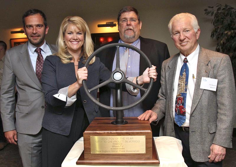 WheelsTV principal Jim Barisano, right, presents his company's POVOTY (Personally Owned Vehicle of the Year) Award to Pierre Kanter (far left) and Laura Toole, both representing General Motors, on behalf of the 2007-2010 Chevrolet Silverado. Keith Griffin, NEMPA President, blesses the event. The trophy is a wheel from a 1937 Chevy pickup
