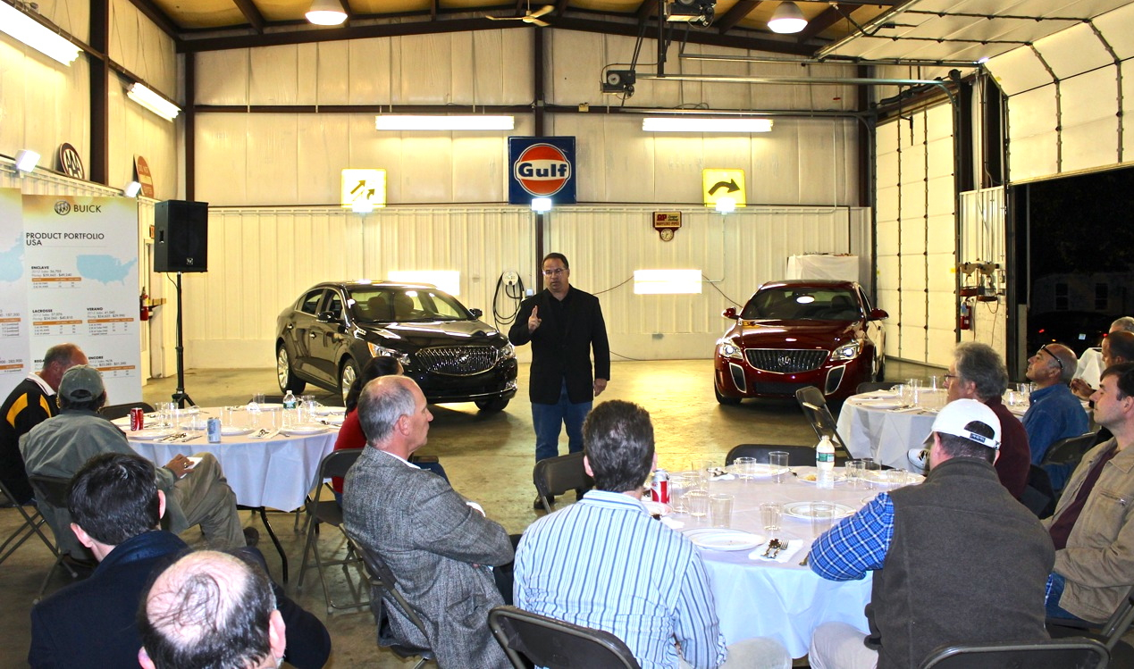 On the evening of October 22, NEMPA gathered at the Automotion garage to catch up on the latest from Buick. Led by V-P of Buick Marketing Tony DiSalle, the visiting team included Brad Saxman (Performance Engineering Manager, LaCrosse & Regal), Katie Bjoerk and Lauren Indiveri (Buick Communications), Steve Martin (GM Communications Northeast) and GM consultant Pierre Kanter.
