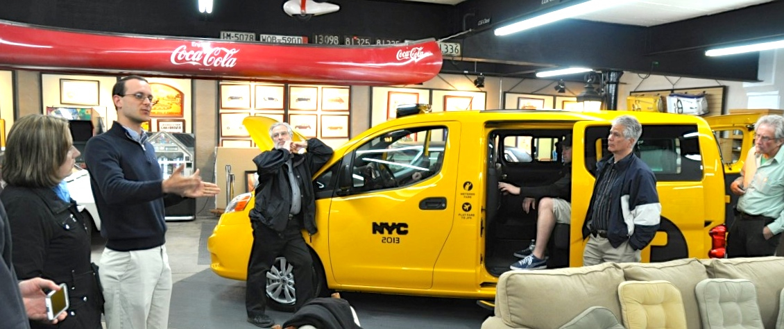 The canary-yellow taxi was sitting outside the Middleboro/Lakeville commuter rail station this raw and drizzly April night. It looked like it was hoping for a fare, but it was just being photographed by the media. A taxi? Well, yes—a brand-new Nissan taxicab, as adopted by New York. Sort of.