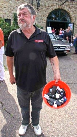 Automotion veteran Cliff Holman gathered the ignition keys in a bucket for the blind draw for cars.