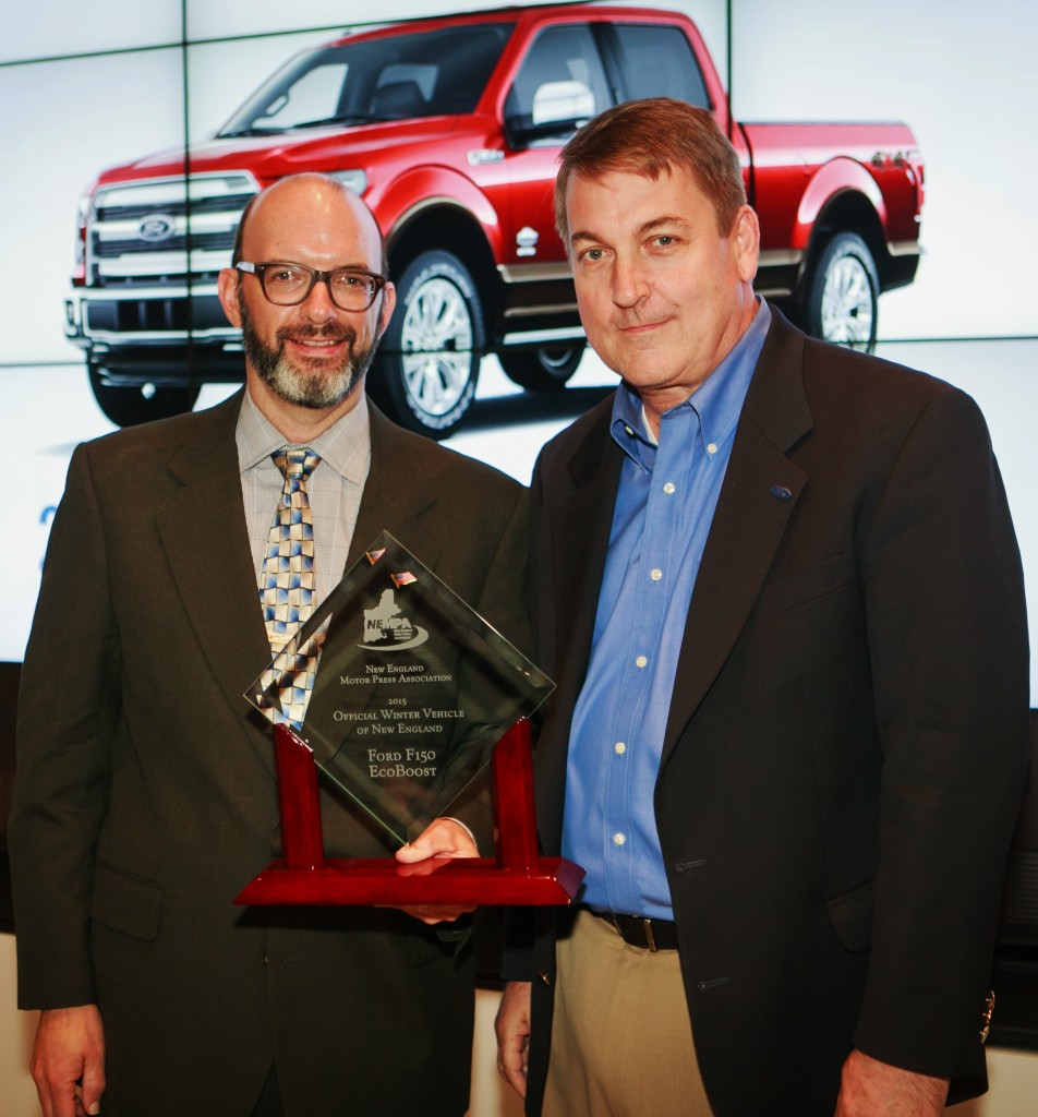 The Ford F-150 with EcoBoost received the award as NEMPA's Official Winter Vehicle of New England at an evening dinner following the technology conference. Chris Brewer (right), chief program engineer for the F-150 and an MIT grad, accepted the award.