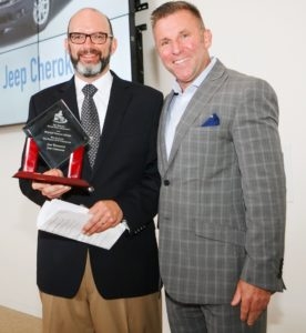 Tom Shanley, Director, FCA Northeast Business Center, accepting the award for Jeep from NEMPA President, Craig Fitzgerald.