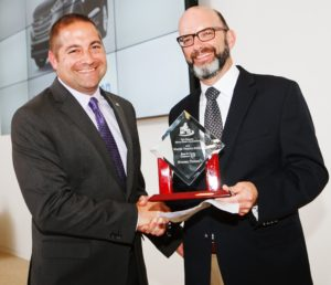 Alex Nunez accepting the award for Hyundai from NEMPA President, Craig Fitzgerald.